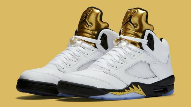 nike air jordan retro v5 gold and white background